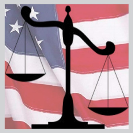 scales of justice and American flag illustrate questions about gerrymandered voting districts