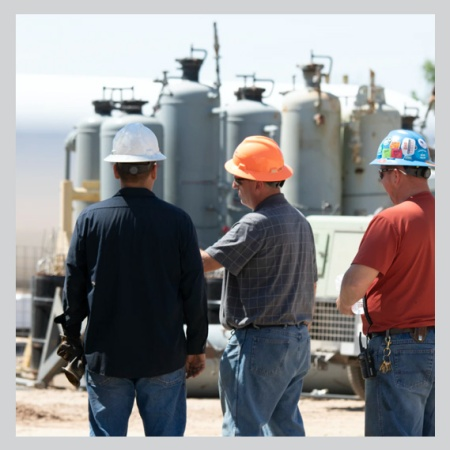 workers have a discussion on site